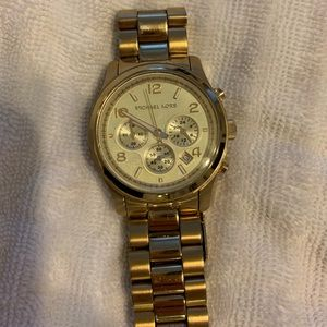 Michael Kors used gold oversized watch